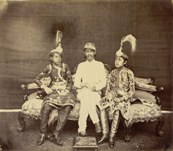 Portrait of Jung Bahadoor in his summer dress with his two elder sons, Generals in Nepalese Army